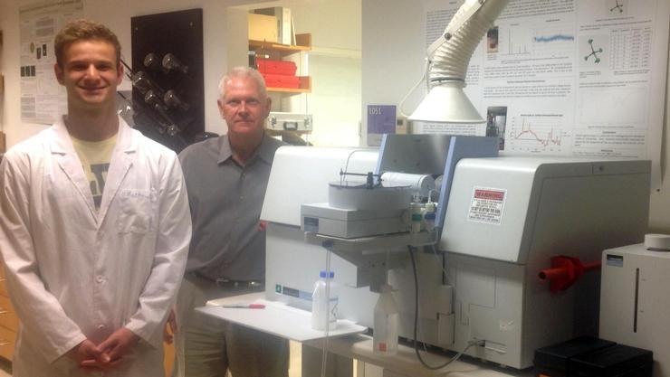 Matt Bleich '18 and Greg Rahn with Hamilton's new atomic absorption spectrometer.