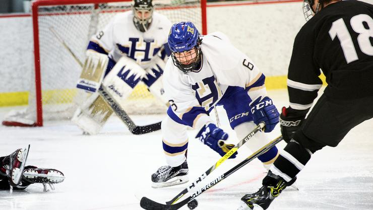 Hamilton's Jonny Stimola '19 tries to steal the puck from Bowdoin's Camil Blanchet.