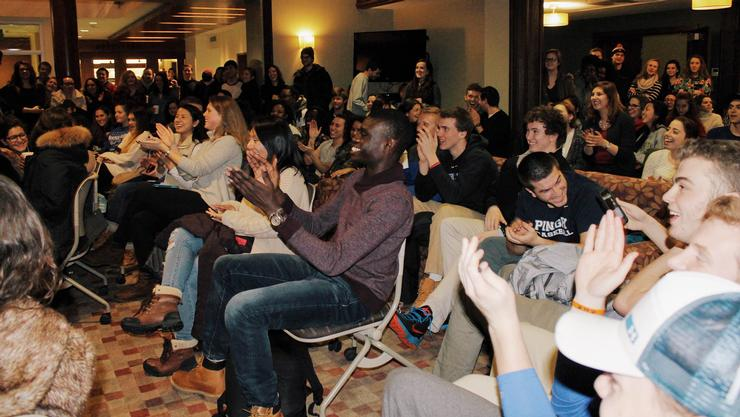 Students crowded Sadove Living Room for the Microfinance Club date auction fundraiser.