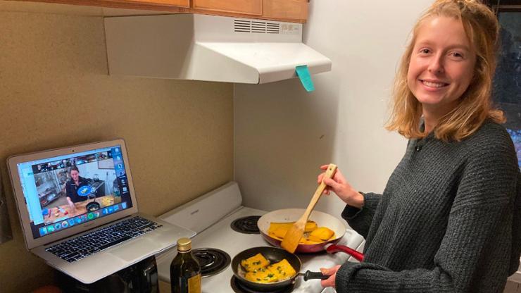 Margaret (Maisie) Merz '21 cooks up some squash during a Quarantine Pantry session.