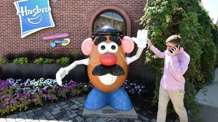 Craig Engert '21 slaps five with Mr. Potato Head outside Hasbro headquarters.