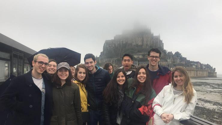Hamilton in France students with Mont Saint Michel shrouded in fog