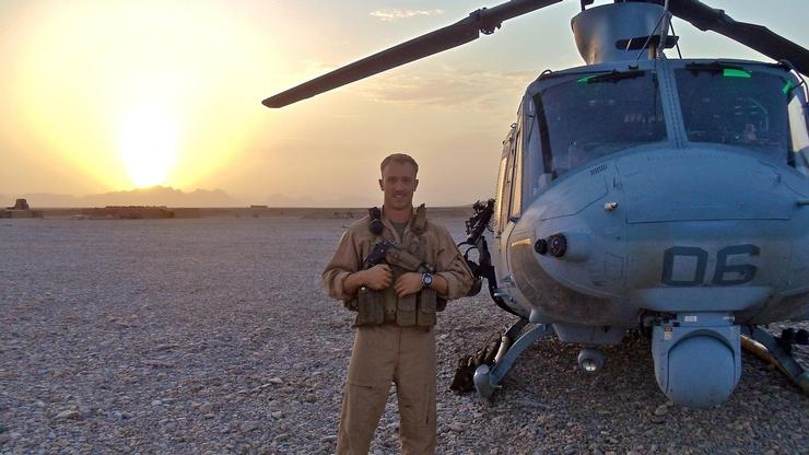 Nicholas Philippi '06 with the helicopter UH-1Y Venom that he flew in the U.S. Marine Corps.
