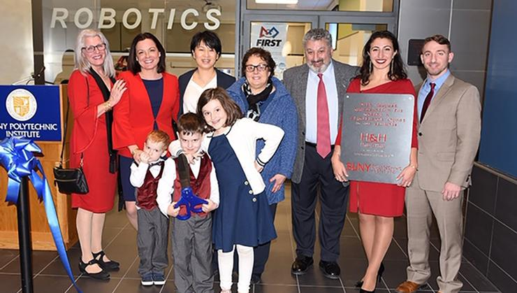 """(left to right) Hedy Hage, Heather Hage '02, SUNY Poly President Grace Wang, NYS Commissioner of General Services RoAnn Destito, Joseph """"J.K."""" Hage '72, Hannah Hage (Union'16), and Gabriel Hage '12. In front of Heather are her three children (left to right), Jameson, CJ, and Sofia."""