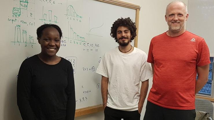 Dara Levy '23, Yassine Dhouib '24, and Visiting Assistant Professor of Computer Science Dave Perkins.