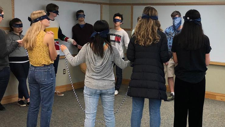 Students in PHIL 120: Perspectives of Self do a rope course exercise.