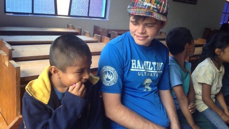 Powell with Enrique at the orphanage.