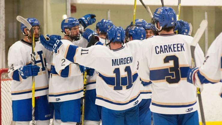 The men's hockey team celebrates its latest win.