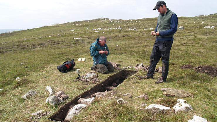 Irish archaeologist John O'Neill and Colin Quinn at the site of an excavation of Bronze Age houses on islands off the coast of Ireland.