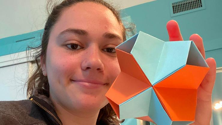 Arielle Saber '20 displays a project from her Creative Coding and Origami class.