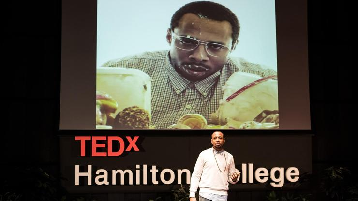 Rapper Saxon Kincy addresses the audience at his TEdX talk.