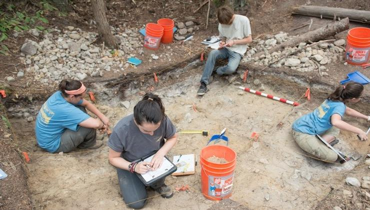 Students take notes at the Slocan Narrows Archaeological site in British Columbia.