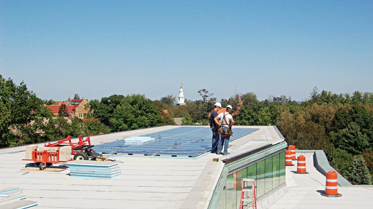 Workers install solar panels on KJ.