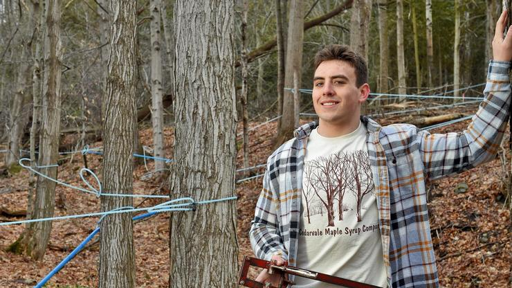 Michael Spicer '21 among the Cedarvale maple trees