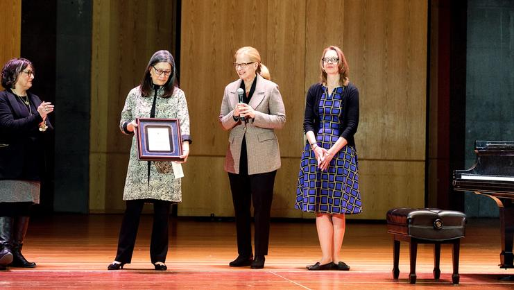 From left: Jo Beth Dellinger from Artists Pianos in Syracuse, Associate Dean of Faculty Penny Yee, Sally Coveleskie of Steinway and Sons and Michelle Reiser-Memmer gather on the Wellin Hall stage to celebrate Hamilton's designation as an