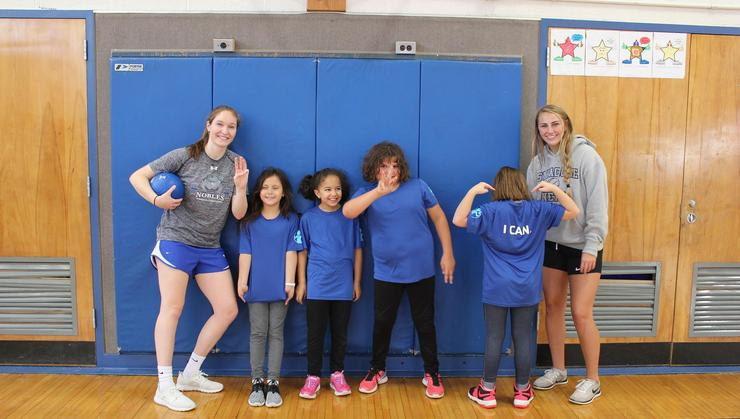 Camille Walter '20 and Carly O'Hearn '20 participate in the Strong Girls Program at the Harts Hill Elementary School in Whitestown.