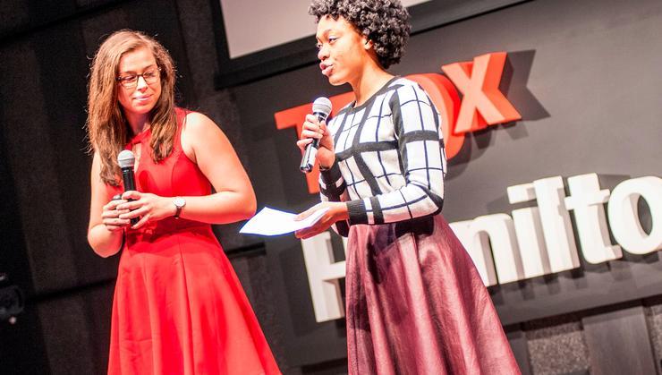 TEDx student organizers Samantha Benevelli '18 and Chidera Onyeoziri '18 introduce the speakers.