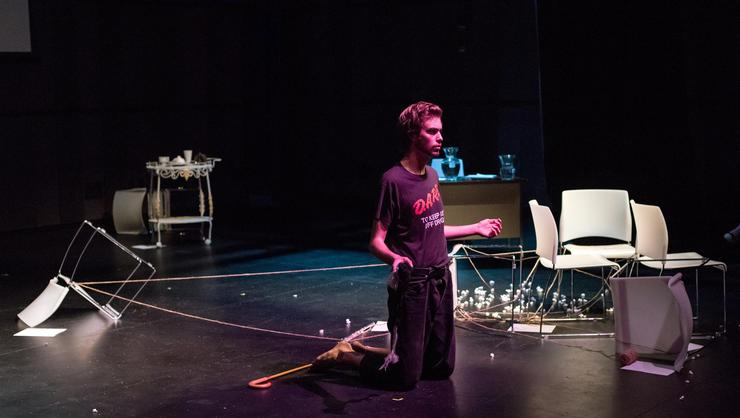 Tim Hartel '18 in a scene from his one-man show <em>Room 101</em>.