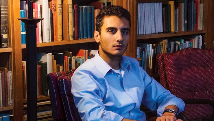 Hady Hewidy '17 in the Christian Johnson Hall browsing room at Hamilton — a long way from his home in Egypt where, as a high school student, he took action for political change.