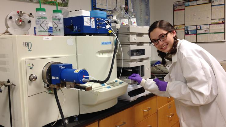 Student researcher and chemistry major Leah Weaver '18 adds samples to the HPLC autosampler connected to one of the Chemistry Department's ion trap mass spectrometers.