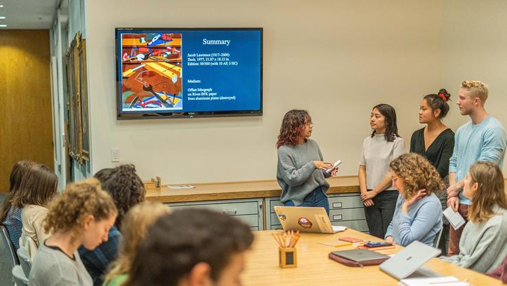 Students representing the work <em>Tools</em> by Jacob Lawrence make their winning pitch for the Wellin acquisition committee.