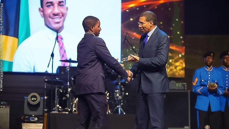 Arthur Williams '16 receives award from Jamaican Prime Minister Holness