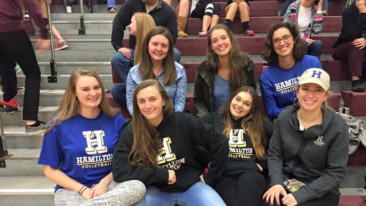 Hamilton volleyball team members at a Clinton girls' match. Bottom row: Jessica Weston '17, Erin Donahue '18, Kyndal Burdin '18, Claire Kitz '19. Top: Meghan Wilkinson '19, Margaret O'Brien '18, head coach Erin Glaser.