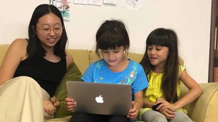 Lynn Kim '21 at Writopia Lab in L.A., with Ruby and Josie.