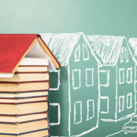 Books and houses drawn on a chalkboard