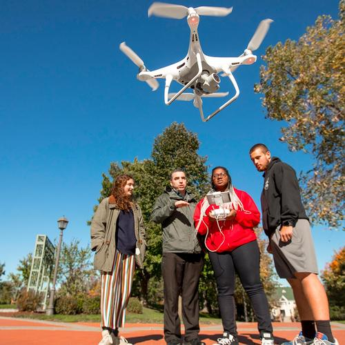 Professor and Students practice with drone