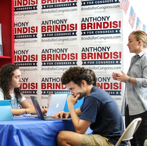 Samantha Gordon '19 and Jonathan Gerstein '21 hear from their supervisor, alumna Eleni Neyland '18, as they volunteer at Brindisi's campaign office