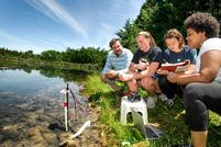 Students Investigate Carbon Output in Wetlands, Lawns, and in Town