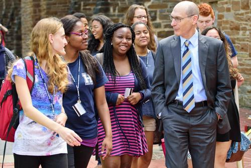President David Wippman with students on campus