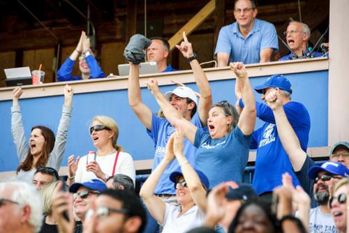 Parents cheering at Fallcoming football game