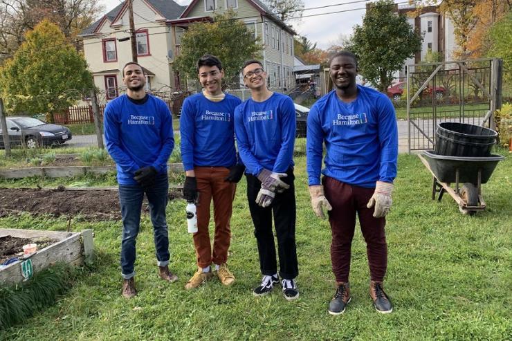 Student Volunteers Clean Up Utica Community Garden