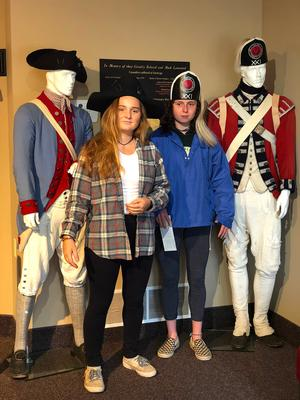 Students pose with traditional uniforms