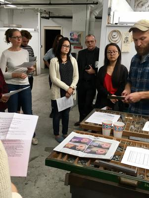 Andrew Rippeon, right, explains letterpress printing.