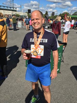 Dave Stone '88 enjoying a beer after running his last marathon