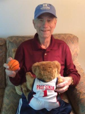 Professor Bob Simon with a gift from the Women's Basketball team.