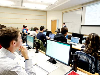 Students listen to Peter Bowley during a 2017 Wall Street Boot Camp session.
