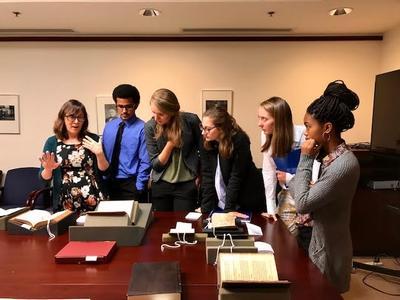 Hamilton Students Contemplate the Tovar Codex with Curator Kim Nusco
