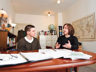 Ginny Dosch talks with Connor Brown '12, who was the recipient of a Barry M. Goldwater Scholarship in 2011