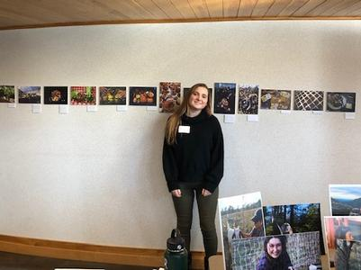 Harff '21 at her exhibition at The W!LD Center