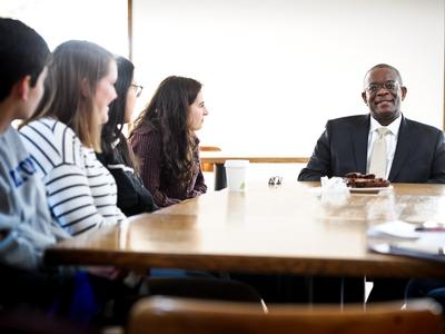 Ambassador Hull meets with students on campus.