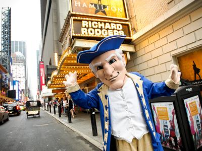 Alex the mascot in NYC by the Hamilton marquee