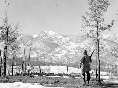 A 10th Mountain Division soldier in February 1945 standing below Riva Ridge in Italy's Northern Apennine Mountains.