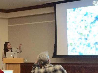 Lauren Scutt '16 presents at the Bucknell Digital Scholarship Conference. Assistant Professor Abhishek Amar is at left.