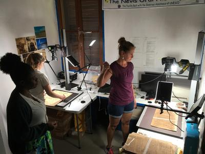 Nevis Historical and Conservation Society Archivist Gail Dore, Sam Wilkerson and Marianita Peaslee at work