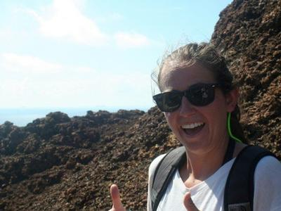 Caitlin Livsey '12 in the Galapagos standing in front of spatter cones