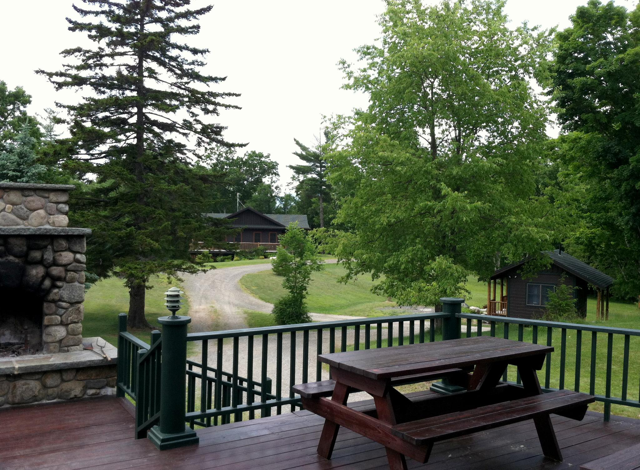 charming the mountain house #7: Shared green space between the buildings at The Mountain House, as seen  from the deck of The Main House, which also serves as our outdoor classroom  and ...